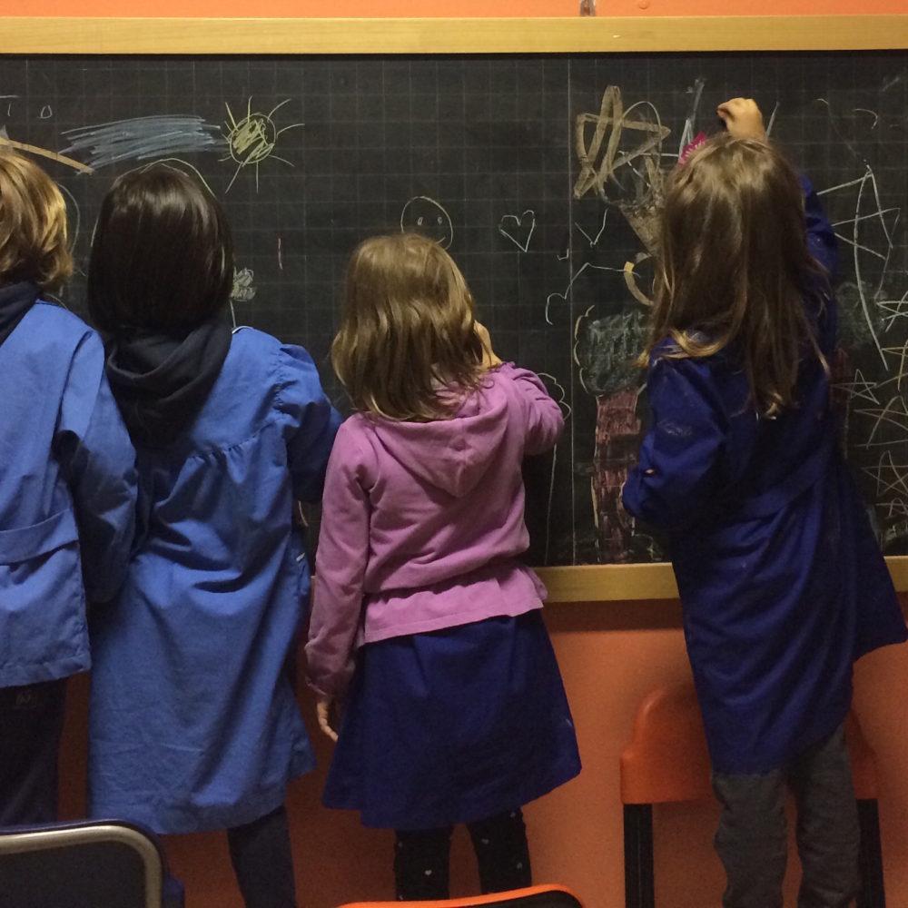 kids-drawing-on-a-blackboard