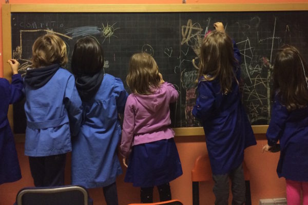 kids-drawing-on-a-blackboard